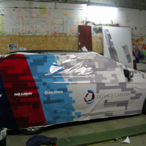 Full car wrap of Navy stationwagon in progress